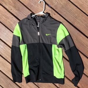 Black, grey, and neon green Nike jacket